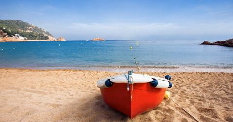 Fishing boat at beach on Costa Brava