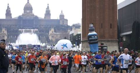 The Barcelona Marathon starts in front of the Montju�c's backdrop
